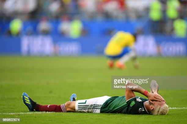 Miguel Layun of Mexico looks dejected following his sides defeat in the 2018 FIFA World Cup Russia Round of 16 match between Brazil and Mexico at...