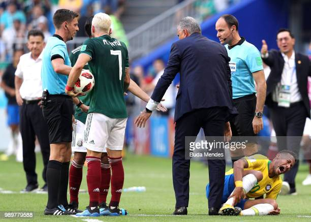 Miguel Layun of Mexico speaks with referee Gianluca Rocchi as Neymar Jr of Brazil goes down injured during the 2018 FIFA World Cup Russia Round of 16...