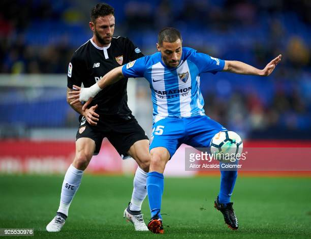 Miguel Layun of Sevilla FC duels for the ball with Medhi Lacen of Malaga CF during the La Liga match between Malaga CF and Sevilla FC at Estadio La...