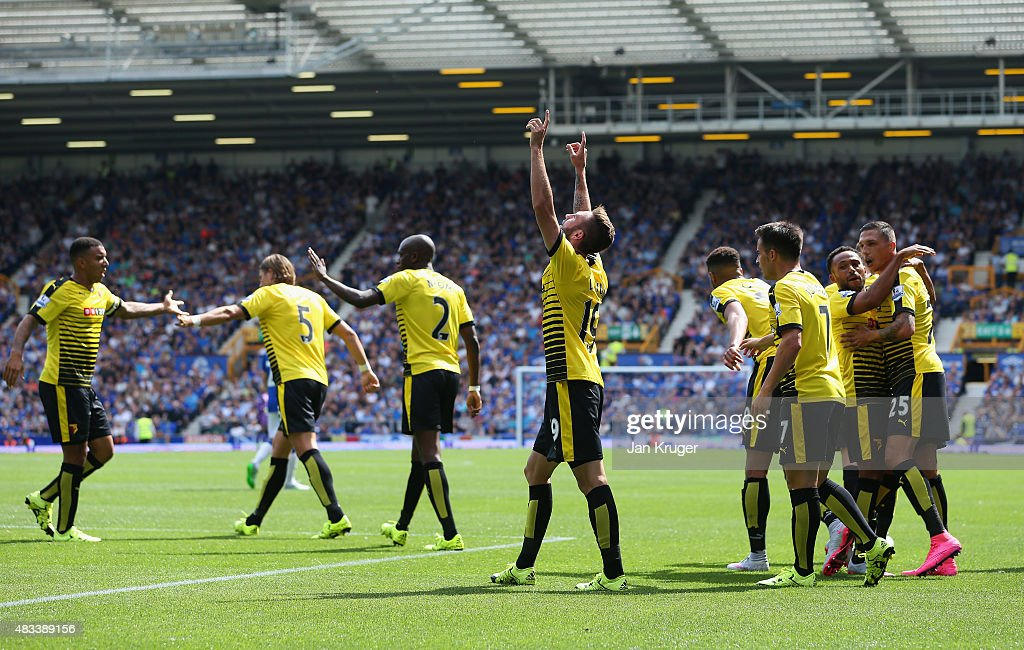 Miguel Layun (C) of Watford celebrates scoring his team's first goal with his team mates during the Barclays Premier League match between Everton and Watford at Goodison Park on August 8, 2015 in Liverpool, England.