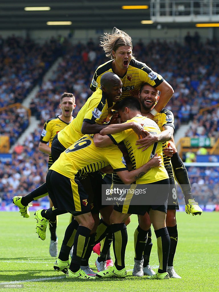 Miguel Layun (L) of Watford celebrates scoring his team's first goal with his team mates during the Barclays Premier League match between Everton and Watford at Goodison Park on August 8, 2015 in Liverpool, England.