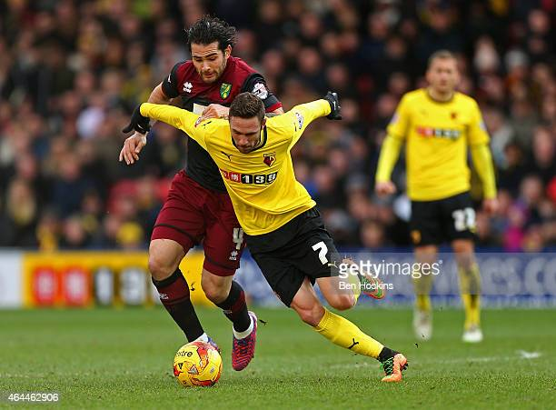 Miguel Layun of Watford holds off the challenge of Bradley Johnson of Norwich during the Sky Bet Championship match between Watford and Norwich City...