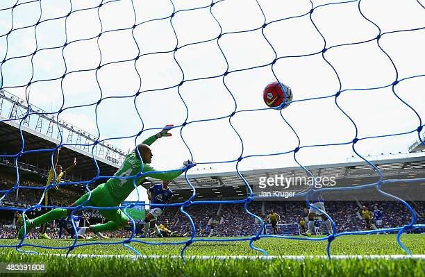 Miguel Layun of Watford scores the opening goal past Tim Howard of Everton during the Barclays Premier League match between Everton and Watford at...