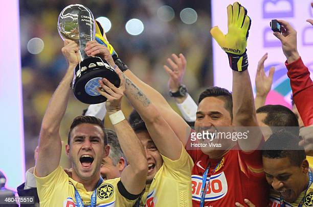 Miguel Layun Rubens Sambueza and Moises Mu–noz of America raise the champions trophy after a Final second leg match between America and Tigres UANL...