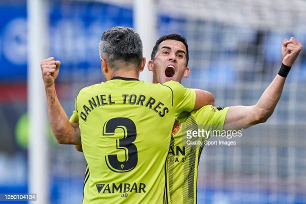 Miguel Linares of Real Zaragoza celebrates with Daniel Torres after scoring his team's third goal during the La Liga Smartbank match between CD Lugo...