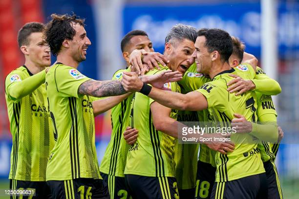 Miguel Linares of Real Zaragoza celebrates with his team mates after scoring his team's third goal during the La Liga Smartbank match between CD Lugo...