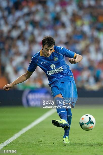 Miguel Marcos alias Michel of Getafe CF strikes the ball during the La Liga match between Real Madrid CF and Getafe CF at Estadio Santiago Bernabeu...