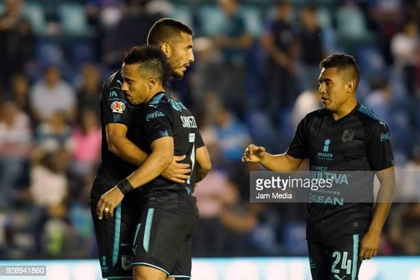 Miguel Martinez Camilo Da Silva and Armando Zamorano of Queretaro celebrate the victory after the 10th round match between Cruz Azul and Queretaro as...