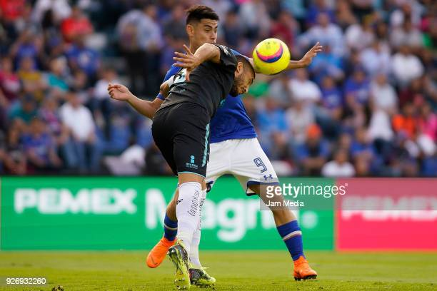 Miguel Martinez of Queretaro and Felipe Mora of Cruz Azul fight for the ball during the 10th round match between Cruz Azul and Queretaro as part of...