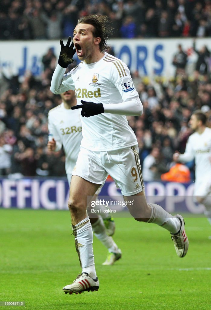 Miguel Michu of Swansea City celebrates as he scores their first goal during the FA Cup with Budweiser Third Round match between Swansea City and Arsenal at Liberty Stadium on January 6, 2013 in Swansea, Wales.