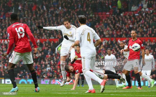 Miguel Michu of Swansea City scores his team's first goal to make the score 11 during the Barclays Premier League match between Manchester United and...