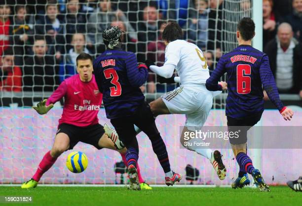 Miguel Michu of Swansea City scores their first goal during the FA Cup with Budweiser Third Round match between Swansea City and Arsenal at Liberty...