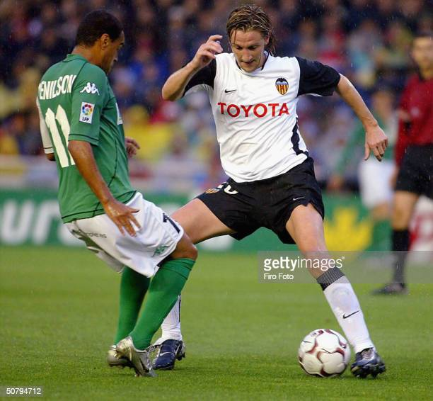 Miguel Mista of Valencia and Denilson of Batis challenge for the ball during the Spanish Primera Liga match between Valencia and Betis at the...