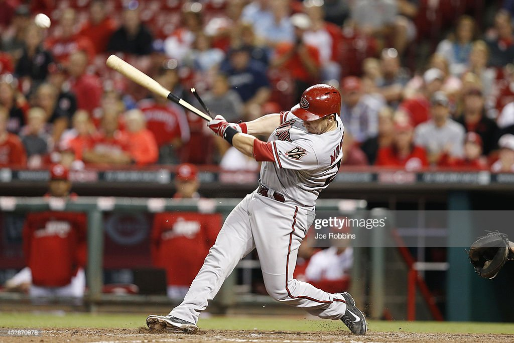 Miguel Montero #26 of the Arizona Diamondbacks breaks his bat as he lines out to shortstop in the 12th inning of the game against the Cincinnati Reds at Great American Ball Park on July 28, 2014 in Cincinnati, Ohio. The Diamondbacks won 2-1 in 15 innings.