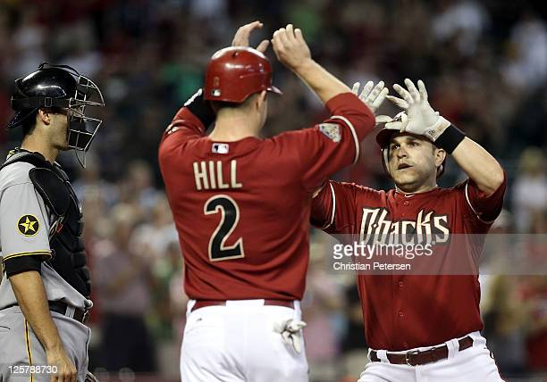 Miguel Montero of the Arizona Diamondbacks highfives Aaron Hill after hitting a tworun home run against the Pittsburgh Pirates during the first...