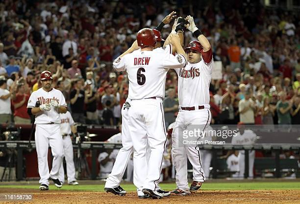 Miguel Montero of the Arizona Diamondbacks highfives teammates Stephen Drew and Chris Young after hitting a threerun home run against the San...