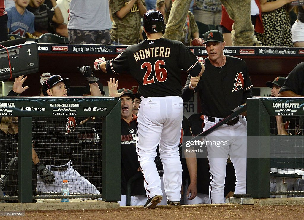 Miguel Montero #26 of the Arizona Diamondbacks is congratulated by Manager Kirk Gibson #23 and teammates after hitting the game tying home run in the tenth inning against the Atlanta Braves at Chase Field on June 7, 2014 in Phoenix, Arizona.