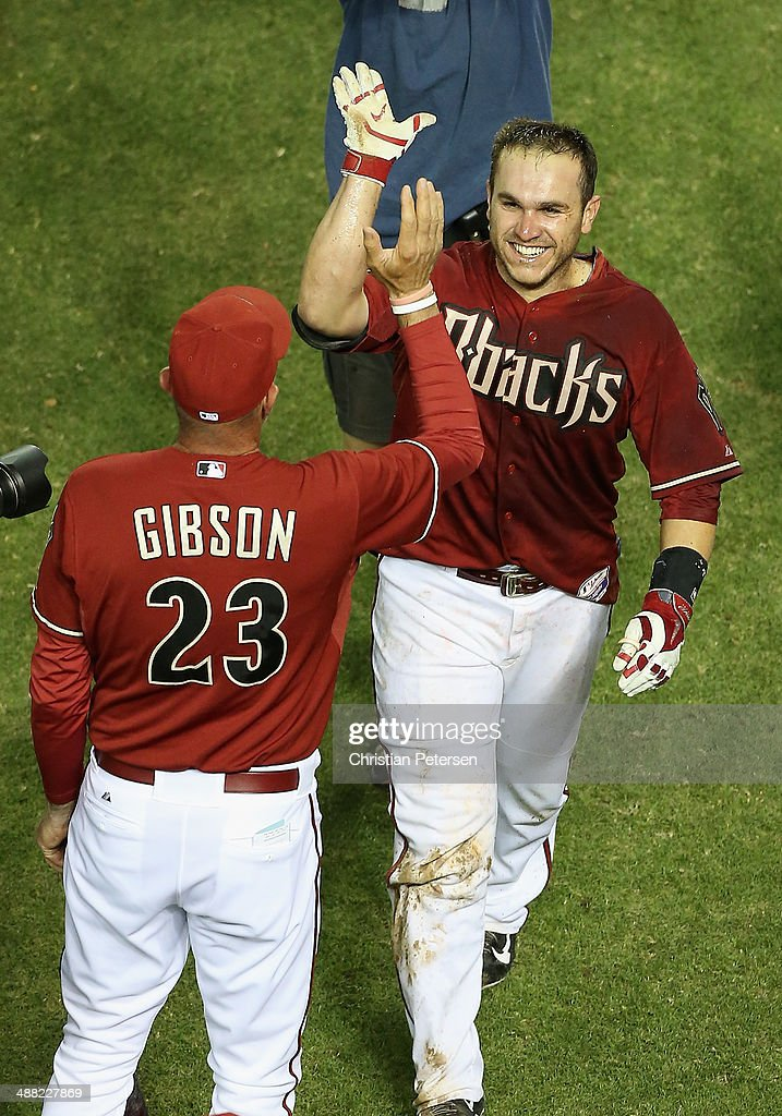 Miguel Montero #26 of the Arizona Diamondbacks is congratulated by manager Kirk Gibson #23 after hitting a walk off solo home run against the Colorado Rockies in the MLB game at Chase Field on April 30, 2014 in Phoenix, Arizona. The Diamodbacks defeated the Rockies 5-4 in 10 innings.