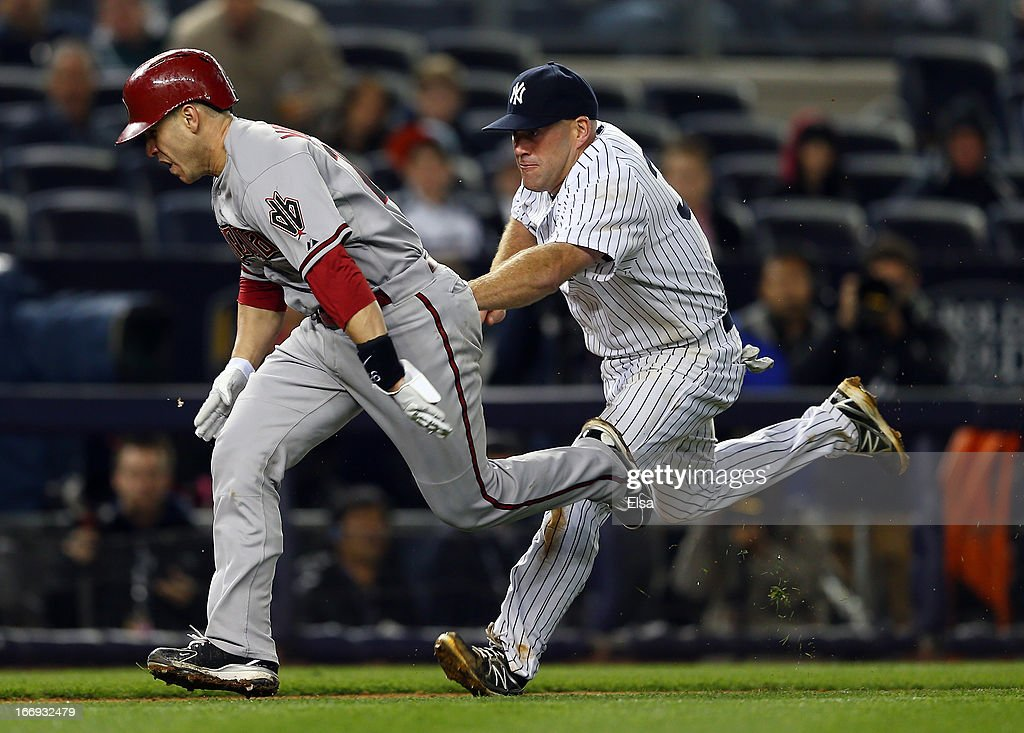Miguel Montero #26 of the Arizona Diamondbacks is tagged out by Kevin Youkilis #36 of the New York Yankees in the eighth inning on April 18, 2013 at Yankee Stadium in the Bronx borough of New York City.