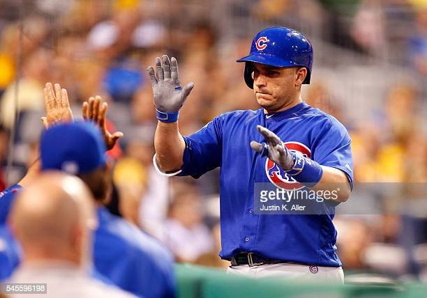 Miguel Montero of the Chicago Cubs celebrates after hitting a two run home run in the sixth inning during the game against the Pittsburgh Pirates at...