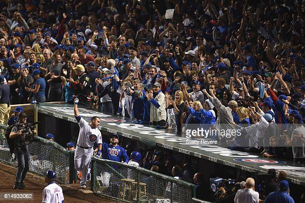 Miguel Montero of the Chicago Cubs celebrates at the dugout after hitting a grand slam home run in the eighth inning against the Los Angeles Dodgers...