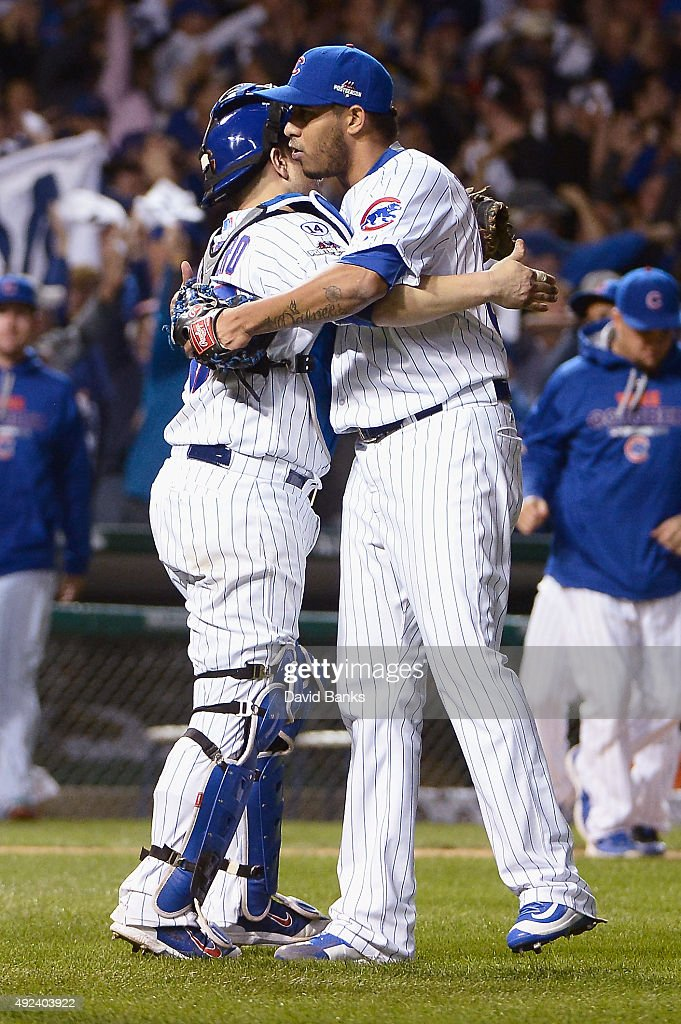 Miguel Montero #47 of the Chicago Cubs celebrates with Hector Rondon #56 of the Chicago Cubs after defeating the St. Louis Cardinals in game three of the National League Division Series at Wrigley Field on October 12, 2015 in Chicago, Illinois. The Chicago Cubs defeat the St. Louis Cardinals with a score of 8 to 6.
