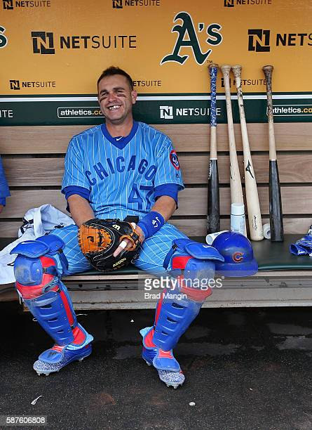 Miguel Montero of the Chicago Cubs gets ready in the dugout before the game against the Oakland Athletics at the Oakland Coliseum on Saturday August...