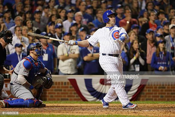 Miguel Montero of the Chicago Cubs hits a grand slam home run in the eighth inning against the Los Angeles Dodgers during game one of the National...