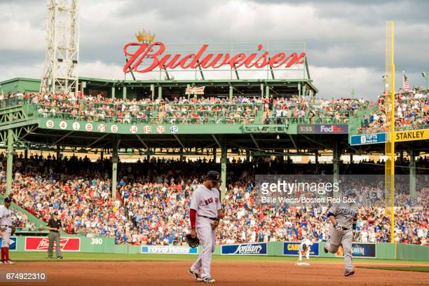 Miguel Montero of the Chicago Cubs rounds the bases after hitting a solo home run during the seventh inning of a game against the Boston Red Sox on...