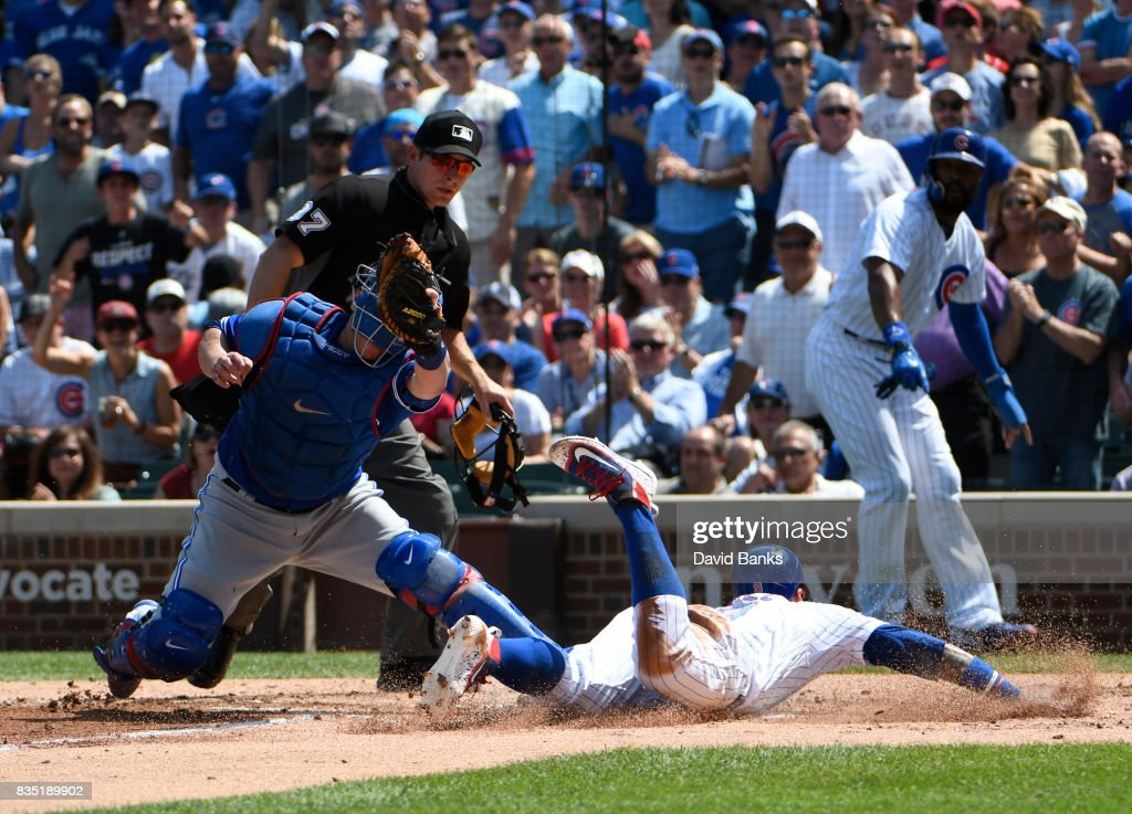 Miguel Montero #47 of the Toronto Blue Jays prepares to tag out Javier Baez #9 of the Chicago Cubs at home plate during the second inning on August 18, 2017 at Wrigley Field in Chicago, Illinois.