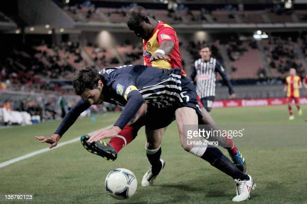 Miguel Morales of Monterrey challenge for the ball with Idrissa Coulibaly of Esperance Sportive de Tunis during the FIFA Club World Cup 5th Place...