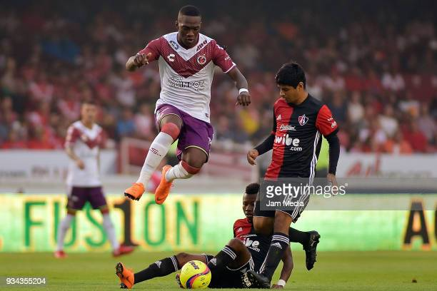 Miguel Murillo of Veracruz and Luis Robles of Atlas compete for the ball during the 12th round match between Veracruz and Atlas as part of the Torneo...