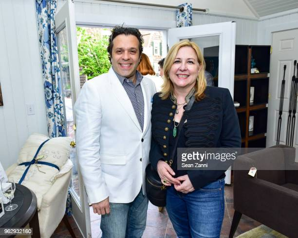 Miguel Oliveira and Deborah Buck attend ARF Thrift Shop Designer Show House Sale at ARF Thrift Treasure Shop on May 26 2018 in Sagaponack New York