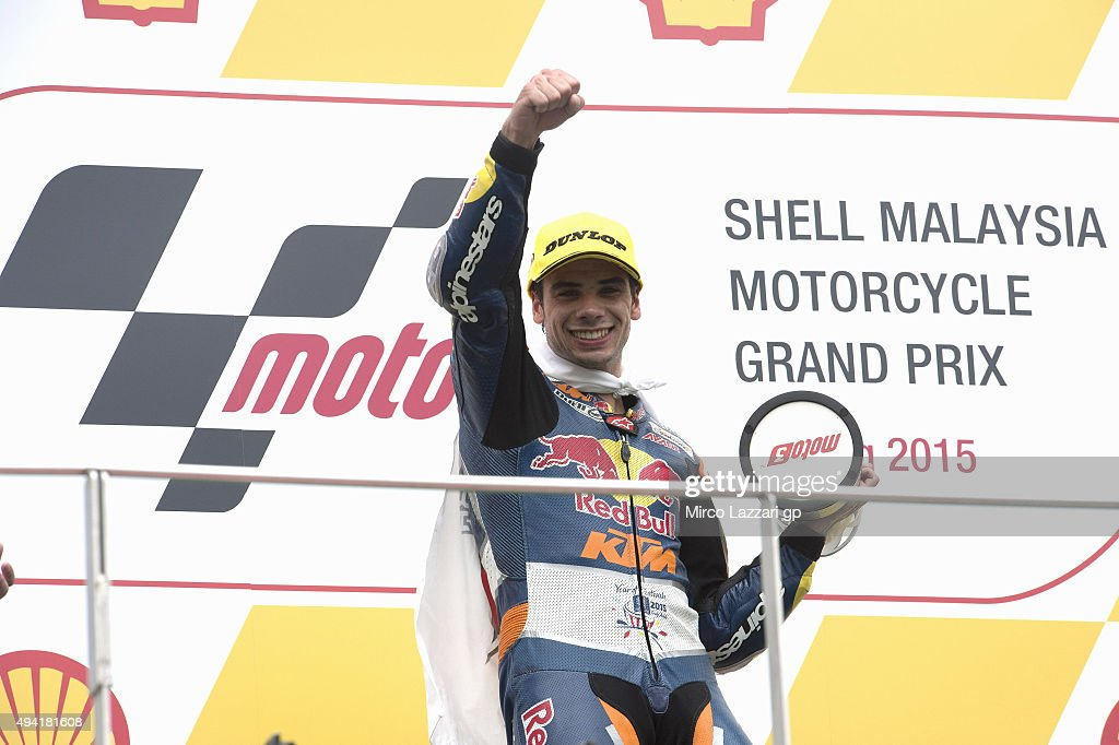 Miguel Oliveira of Portugal and Red Bull KTM Ajo celebrates his victory on the podium at the end of the Moto3 race during the MotoGP Of Malaysia at Sepang Circuit on October 25, 2015 in Kuala Lumpur, Malaysia.