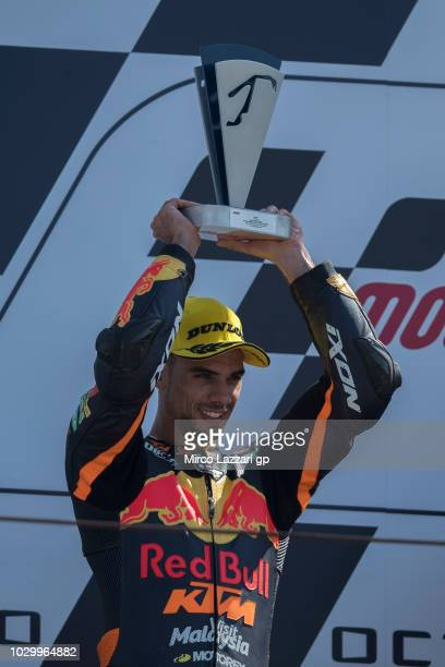Miguel Oliveira of Portugal and Red Bull KTM Ajo celebrates the second place on the podium at the end of the Moto2 race during the MotoGP of San...