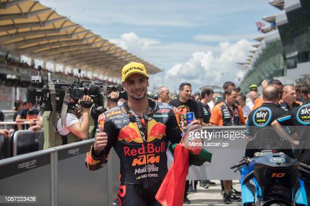 Miguel Oliveira of Portugal and Red Bull KTM Ajo celebrates the second place under the podium during the Moto2 race during the MotoGP Of Malaysia...