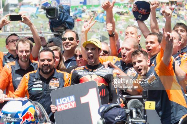 Miguel Oliveira of Portugal and Red Bull KTM Ajo celebrates the victory with team under the podium at the end of the Moto2 race during the MotoGp of...