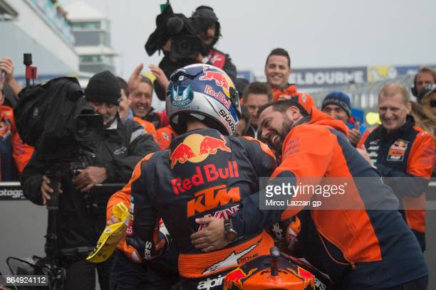 Miguel Oliveira of Portugal and Red Bull KTM Ajo celebrates victory with team under the podium at the end of the Moto2 race during the 2017 MotoGP of...