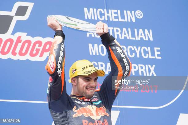 Miguel Oliveira of Portugal and Red Bull KTM Ajo celebrates victory on the podium at the end of the Moto2 race during the 2017 MotoGP of Australia at...