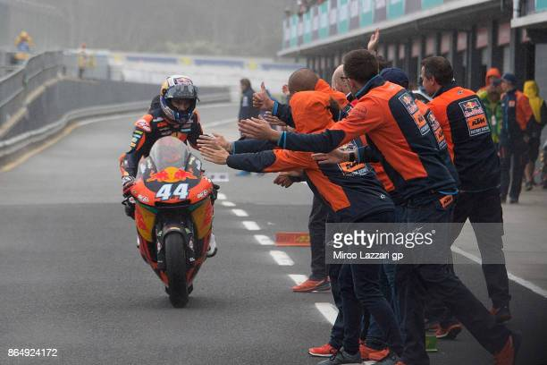 Miguel Oliveira of Portugal and Red Bull KTM Ajo celebrates victory under the podium at the end of the Moto2 race during the 2017 MotoGP of Australia...