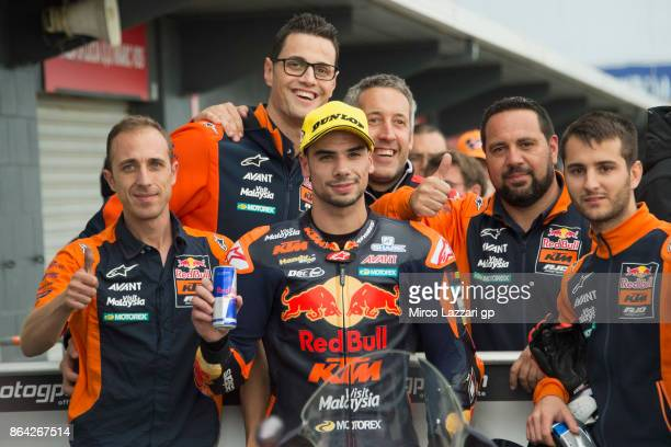 Miguel Oliveira of Portugal and Red Bull KTM Ajo celebrates with team at the end of the Moto2 qualifying practice during qualifying for the 2017...