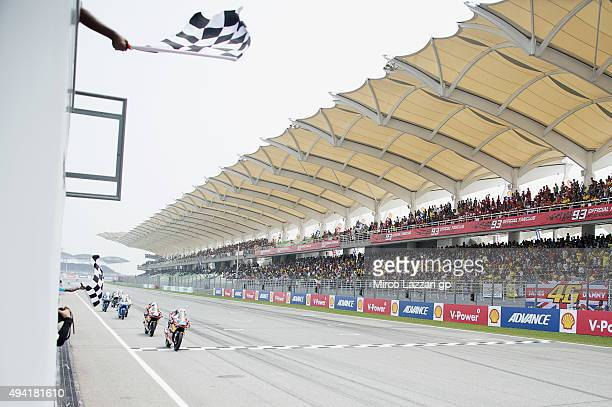 Miguel Oliveira of Portugal and Red Bull KTM Ajo cuts the finish lane and celebrates his victory at the end of the Moto3 race during the MotoGP Of...