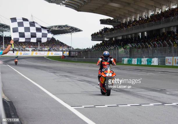 Miguel Oliveira of Portugal and Red Bull KTM Ajo cuts the finish lane and celebrates the victory at the end of the Moto2 race during the MotoGP Of...