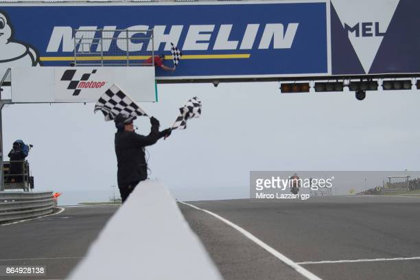 Miguel Oliveira of Portugal and Red Bull KTM Ajo cuts the finsish lane and celebrates victory at the end of the Moto2 race during the 2017 MotoGP of...