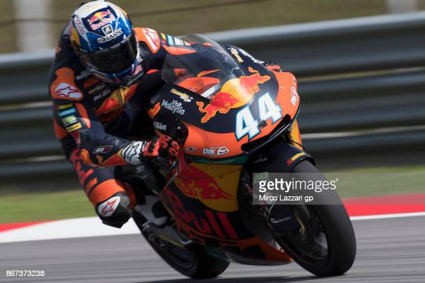 Miguel Oliveira of Portugal and Red Bull KTM Ajo heads down a straight during the qualifying practice during the MotoGP Of Malaysia Qualifying at...