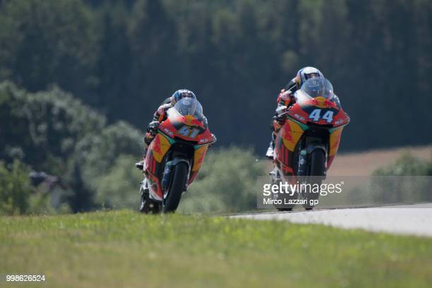 Miguel Oliveira of Portugal and Red Bull KTM Ajo leads Brad Binder of South Africa and Red Bull KTM Ajo during the qualifying practice during the...