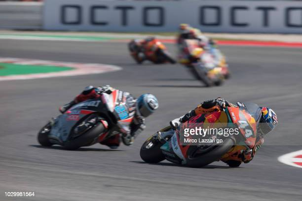 Miguel Oliveira of Portugal and Red Bull KTM Ajo leads the field during the Moto2 race during the MotoGP of San Marino Race at Misano World Circuit...
