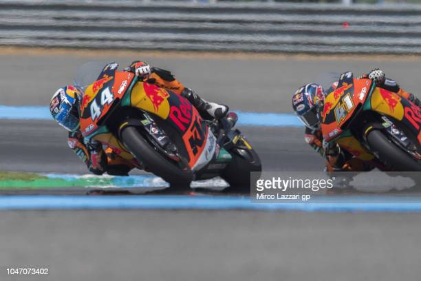 Miguel Oliveira of Portugal and Red Bull KTM Ajo leads the field during the Moto2 race during the MotoGP Of Thailand Race on October 7 2018 in Buri...