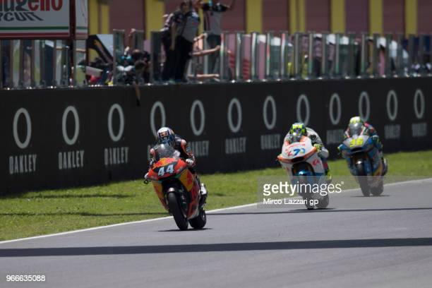 Miguel Oliveira of Portugal and Red Bull KTM Ajo leads the field during the Moto2 race during the MotoGp of Italy Race at Mugello Circuit on June 3...