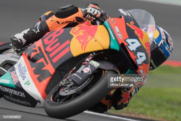 Miguel Oliveira of Portugal and Red Bull KTM Ajo rounds the bend during the MotoGp Of Great Britain Free Practice at Silverstone Circuit on August 24...